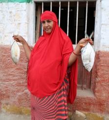 Shakila Sadik Hashim, an employee at Alla Amin Fishing with the morning catch.