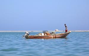 Anchoring a fishing boat in Berbera harbor.